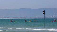People having fun paddling their canoe and kayak in mediterranean Stock Footage