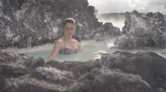Beautiful woman relaxing in hot spring pool Stock Footage