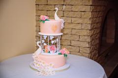 Sweet multilevel wedding cake decorated with flowers Stock Photos