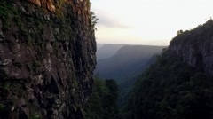 Drone aerial tracking along rockface Through Vally at Gods Window Stock Footage