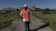Worker with sledgehammer walking away.4k Stock Footage