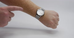 Late For Work Man Pointing at Wrist Watch Isolated on White, 4K  Stock Footage