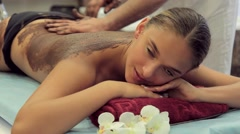 Masseur makes chocolate wrapping young woman Stock Footage