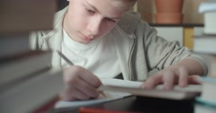 Teenager working on a homework assignment. Close up Stock Footage