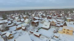 Aerial survey from the air. Winter. Holiday village in Siberia Stock Footage