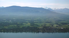 Swiss coast of Geneva (Leman) lake around Anieres with the Mont Blanc Stock Footage