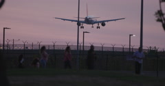 LAX Jet Lands with people in foreground. Stock Footage