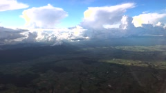 Swiss countryside with massive clouds in the background, aerial view Stock Footage
