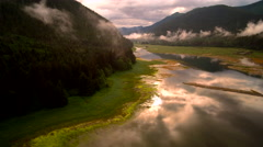 Sunset Aerial over Misty River Valley Inlet Stock Footage