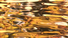 Shimmering golden water transition effect Stock Footage