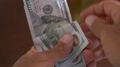 Close-up of a businessman hands counting hundred dollar bills in hand Stock Footage