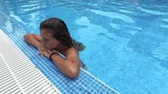 Beautiful teen girl refresh in luxury pool, 4k steadicam Stock Footage
