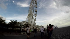 Underside view of a ferris wheel over dark sky Stock Footage