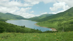 Lake Nozori morning wide angle and flower field Stock Footage