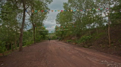 Camera Moves along Wet Ground Road by Green Slopes Stock Footage