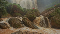 Cascade of Stormy Mountain Brown Water River among Stones Stock Footage
