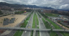 Sailing over Avenida El Dorado towards downtown Bogota Stock Footage
