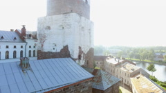 Flying around very old castle in Viborg sunny day Stock Footage