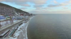 Aerial survey from the air. Winter. Lake Baikal. Listvyanka Stock Footage