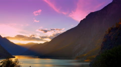 4K Pink and Gold Sunset, Sun Rays Over Mountains Crepuscular Rays, Golden Hour Stock Footage