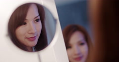 Beautiful Asian woman brushing hair while looking in mirrors 4K Stock Footage