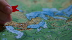 Pin specify the location on the map closeup Stock Footage