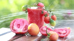 Running water flowing on tomatoes and tomato juice in the woods summer day Stock Footage