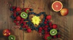 4k Colourful Composition of Fresh Fruits Heart Shaped- Wooden Background Stock Footage