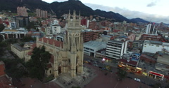 Low aerial circling around Bogota's Lourdes church Stock Footage