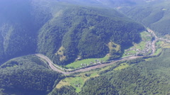 Nice view from the air. road through the forest in the mountains Stock Footage