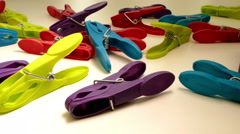 Slider shot across colourful pegs and clothes. Stock Footage