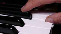 Piano keyboard, with hand playing. Stock Footage