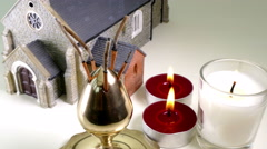 Model church, incense sticks and lighted candles. Stock Footage