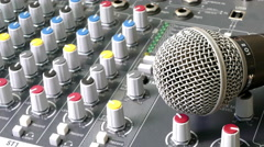 An audio mixing desk, with microphone. Stock Footage