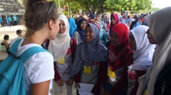 Tourist Woman Speaking with Muslim School Girls Stock Footage