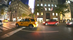 NEW YORK CITY – OCTOBER 2015: Midtown city traffic at night. New York attracts Stock Footage