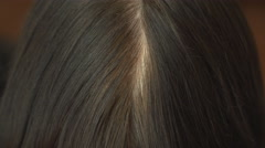 An adult woman, close-up shows the gray hair. Stock Footage