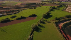 Aerial view of German landscape and gravel pit Stock Footage