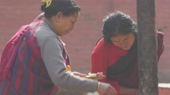 Two woman do a hindu ceremony,Patan,Nepal Stock Footage