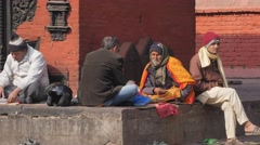 People and priest at temple complex,Patan,Nepal Stock Footage