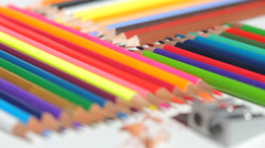 Color pencils and pencil sharpener Stock Footage