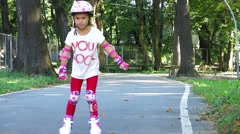 Girl Rides On Roller Skates Stock Footage