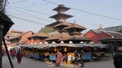 Kumbeshwar temple and flower stalls,Patan,Nepal Stock Footage