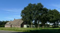 Farmhouse in Dutch landscape Stock Footage