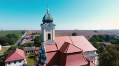 4K aerial shot of the historic church on summer day with blue sky (color edit) Stock Footage