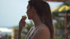 Girl eating ice cream. A little shy Stock Footage