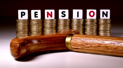 £1 coins, 'pension' in letters and a wooden cane. Stock Footage