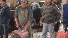 Butcher cutting sacrificed goat meat at Kali temple,Dakshinkali,Nepal Stock Footage