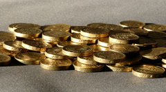 Slider shot across a pile of £1 sterling coins. Stock Footage