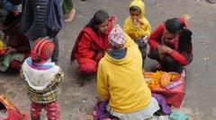 Mother and child get Tilaka mark on forehead by hindu priest,Dakshinkali,Nepal Stock Footage